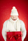 Man with open gift box — Stock Photo
