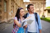 Couple of travelers with map — Stock Photo