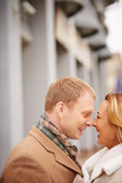 Amorous man and woman laughing — Stock Photo