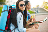 Pretty traveler with companion — Stock Photo