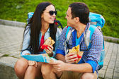 Happy travelers eating fast food — Stock Photo