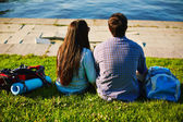 Couple having rest on lawn — Foto Stock