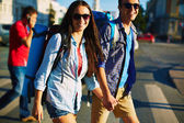 Smiling couple with backpacks — Stock Photo