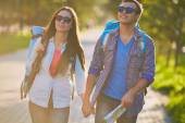 Couple with backpacks — Stock Photo
