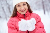 Girl with handful of snow — Stock Photo