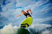 Male surfer riding on board — Stock Photo