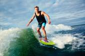 Surfer riding on waves — Stock Photo