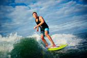 Surfboarder riding on waves — Stock Photo