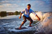 Young man surfboarding — Stock Photo
