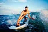 Surfboarder practicing surfboarding — Stock Photo