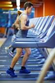 Man running in gym — Stock Photo