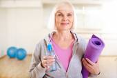 Mature woman with bottle of water — Stock Photo