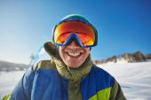 Smiling snowboarder — Stock Photo