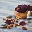 Petals and vial with rose essence — Stock Photo #58577685