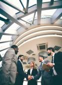 Happy businessmen handshaking — Stock Photo