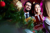 Employees congratulating colleague on Christmas — Stock Photo