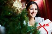 Businesswoman with xmas giftbox — Stock Photo
