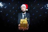Businessman in Santa cap holding giftbox — Stock Photo