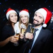 Cheerful business people in Santa caps — Stock Photo #58580031