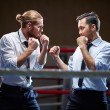 Businessmen fighting on boxing ring — Stock Photo #58580713