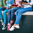 Girls in jeans reading outside — Stock Photo #58581971