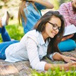 Girl doing her homework in park — Stockfoto #58582055