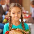Girl with cooked turkey — Photo #58582209