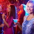 Girl with cocktail in nightclub — Stock Photo #58583087