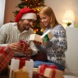 Couple opening Christmas gift boxes — Stock Photo #58584663