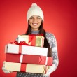 Girl in winter wear holding gift boxes — Stock Photo #58585093