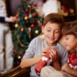 Children opening Christmas gift — Stock Photo #58585335