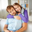Couple sitting on sofa at home — Stock Photo #58585957