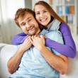 Couple sitting on sofa at home — Stock Photo #58585989