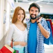 Couple with paperbags in shopping mall — Stock Photo #58586523