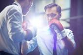 Businessman in boxing gloves — Stock Photo