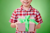 Little boy holding  pink package — Stok fotoğraf