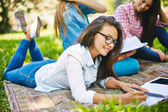 Girl doing her homework in park — Stock Photo
