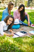 Teenage women making notes in park — Stock Photo