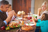 Family sitting at Thanksgiving festive table — Stock Photo
