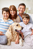 Family with Labrador dog — Stock Photo