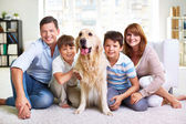 Family with Labrador dog — Foto Stock