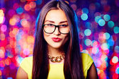 Flirty girl in eyeglasses — Stock Photo