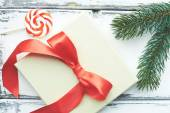 Christmas lollipop, conifer and card — Stock Photo