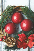Red bubbles in xmas wreath — Stock Photo