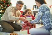 Family packing Christmas gifts — Stock Photo
