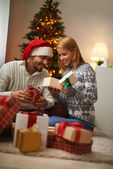 Couple opening Christmas gift boxes — Stock Photo