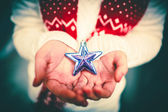 Christmas  star in woman — Stock Photo