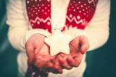 White Christmas star on hands — Stock Photo