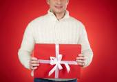 Man holding red gift box — Stock Photo