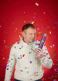 Man with confetti cracker — Stock Photo